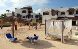 Hacienda Del Secreto has a Private Beach Club with Tanning Beds, Palapas for shade and Vollyball Court