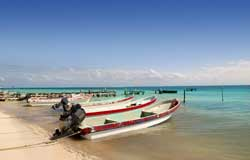 Puerto Morelos, Mexico - Fishing Boats on beach done for the day.