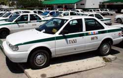 Cancun Taxis have a green stripe