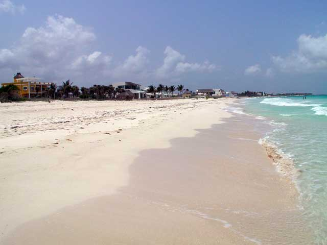 The beach in front of  Villa Sol y Luna has white sand is great for walking.